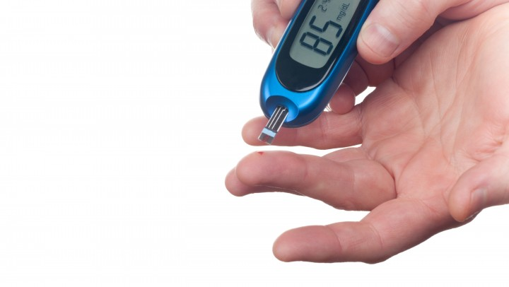 Glucose level finger blood test over white